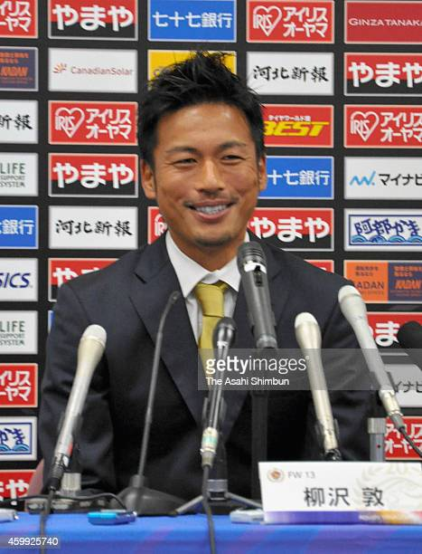 Former Japanese International Atsushi Yanagisawa of Vegalta Sendai speaks during a press conference to announce his retirement at Yurtec Stadium...