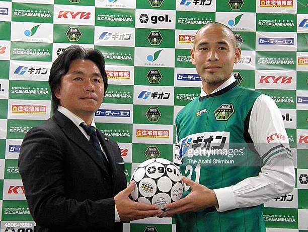 Former Japanese international Naohiro Takahara poses for photographs with SC Sagamihara head coach Tetsumasa Kimura during his joining press...