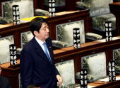 Former Japanese Prime Minister Shinzo Abe attends the plenary session at the House of Representatives on November 13 2007 in Tokyo Japan The Bill...