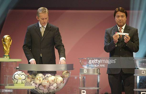 Former Japanese soccer player Yasuhiko Okudera starts the draw for the Asian countries of the preliminary round of the 2006 World Cup in Germany At...