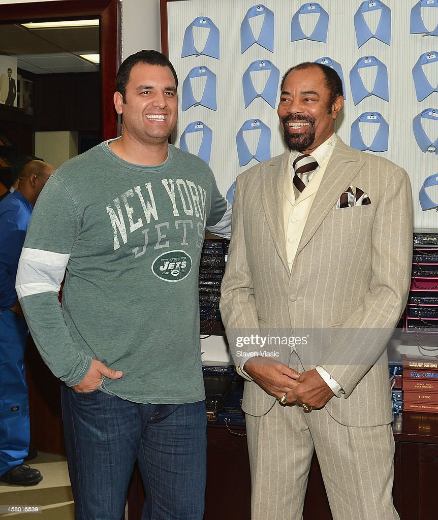 Former Jets player Anthony Becht (L) and former basketball player Walt 'Clyde' Frasier attend the 2013 Mohan's Winter Coat Drive benefiting The Doe Fund at Mohan's Custum Tailors on December 19, 2013 in New York, United States.