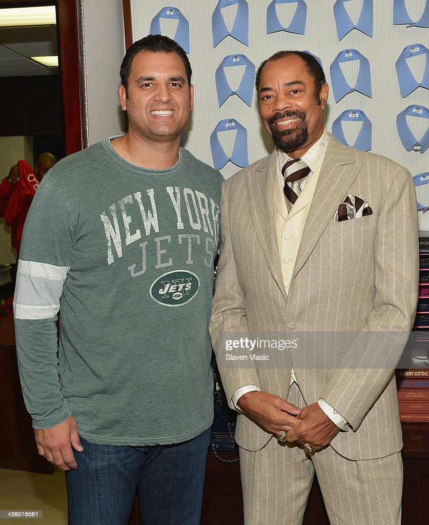 Former Jets player <a gi-track='captionPersonalityLinkClicked' href=/galleries/search?phrase=Anthony+Becht&family=editorial&specificpeople=213273 ng-click='$event.stopPropagation()'>Anthony Becht</a> (L) and former basketball player Walt 'Clyde' Frasier attend the 2013 Mohan's Winter Coat Drive benefiting The Doe Fund at Mohan's Custum Tailors on December 19, 2013 in New York, United States.