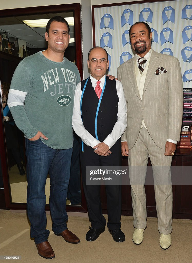 Former Jets player Anthony Becht, Mohan Ramchandani and former basketball player Walt 'Clyde' Frasier attend the 2013 Mohan's Winter Coat Drive benefiting The Doe Fund at Mohan's Custum Tailors on December 19, 2013 in New York, United States.