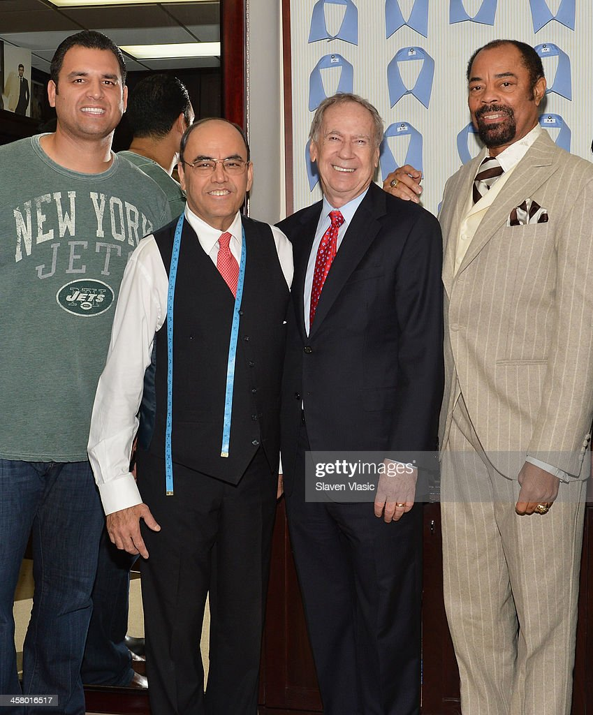 Former Jets player Anthony Becht, Mohan Ramchandani, Doe Fund founder George McDonald and former basketball player Walt 'Clyde' Frasier attend the 2013 Mohan's Winter Coat Drive benefiting The Doe Fund at Mohan's Custum Tailors on December 19, 2013 in New York, United States.