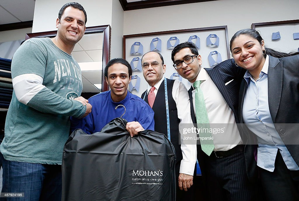 <a gi-track='captionPersonalityLinkClicked' href=/galleries/search?phrase=Anthony+Becht&family=editorial&specificpeople=213273 ng-click='$event.stopPropagation()'>Anthony Becht</a>, Mohan Ramchandani, Doe Fund recipient of a suit and employees attend the 2013 Mohan's Winter Coat Drive Benefiting The Doe Fund a Mohan's Custum Tailors on December 19, 2013 in New York City.