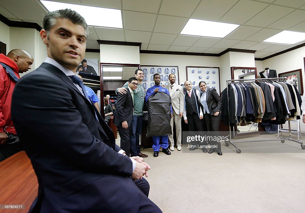 Anthony Becht, Mohan Ramchandani, Walt Clyde Frasier, employees and Doe Fund Recipients employees attend the 2013 Mohan's Winter Coat Drive Benefiting The Doe Fund a Mohan's Custum Tailors on December 19, 2013 in New York City.