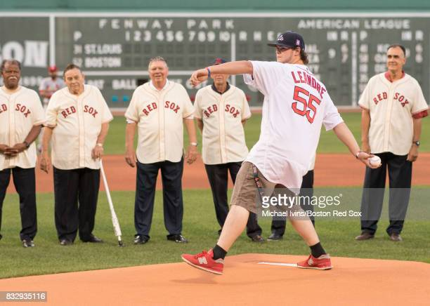 Former Jimmy Fund patient Jordan Leandre throws out a ceremonial first pitch before a game between the Boston Red Sox and the St Louis Cardinals on...