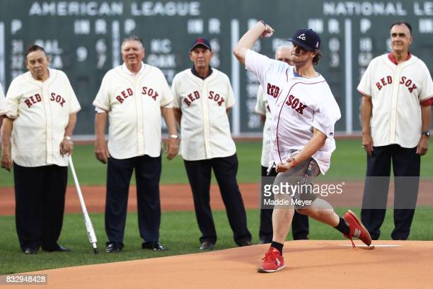 Former Jimmy Fund patient Jordan Leandre throws out the first pitch before the game between the Boston Red Sox and the St Louis Cardinals at Fenway...