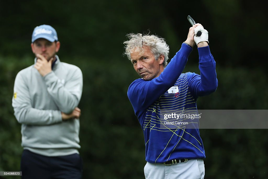 Former jockey John Francome plays a shot watched by <a gi-track='captionPersonalityLinkClicked' href=/galleries/search?phrase=Bernd+Wiesberger&family=editorial&specificpeople=4025132 ng-click='$event.stopPropagation()'>Bernd Wiesberger</a> of Austria during the Pro-Am prior to the BMW PGA Championship at Wentworth on May 25, 2016 in Virginia Water, England.