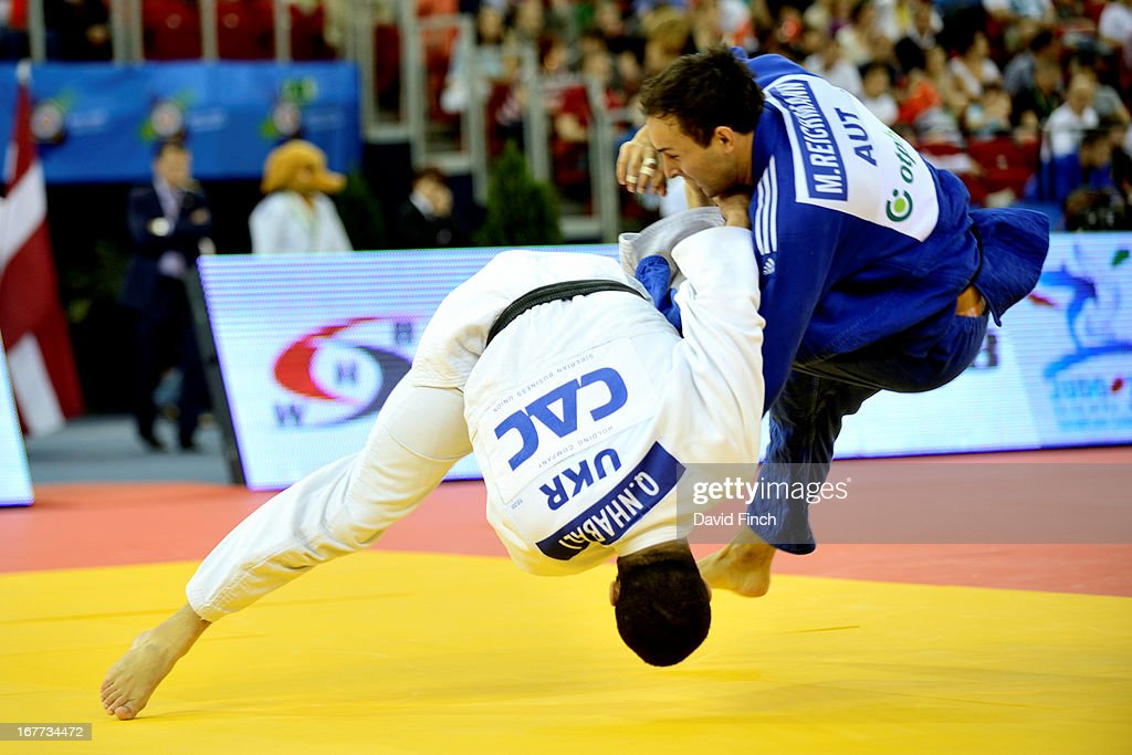 Former junior World champion, Quedjau Nhabali of Ukraine (white), throws Manuel Reichmann of the Austrian team for ippon (10 points) at the Budapest European Team Championships held at the Papp Laszlo Sports Hall, on April 28, 2013 Budapest, Hungary.