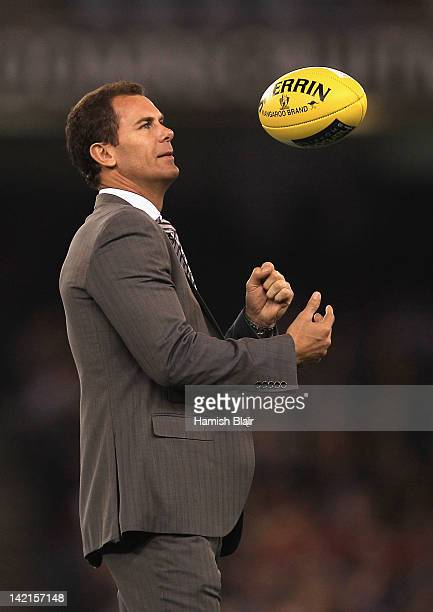 Former Kangaroos player Wayne Carey prepare to hand the match ball to the umpires ahead of the round one AFL match between the North Melbourne...