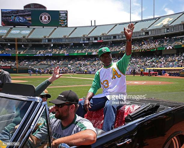 Former Kansas City Athletics star John 'Blue Moon' Odom waves to the fans during turn back the clock day ceremonies before the game against the...