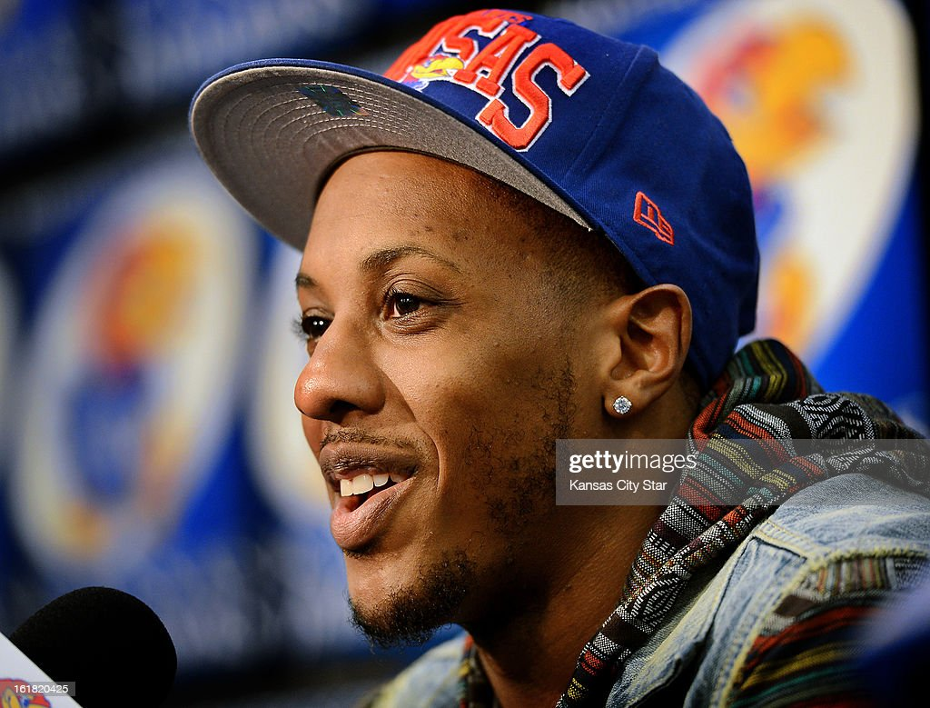 Former Kansas star Mario Chalmers speaks during a news conference before the Jayhawks tipped off against Texas at Allen Fieldhouse in Lawrence, Kansas, on Saturday, February 16, 2013.