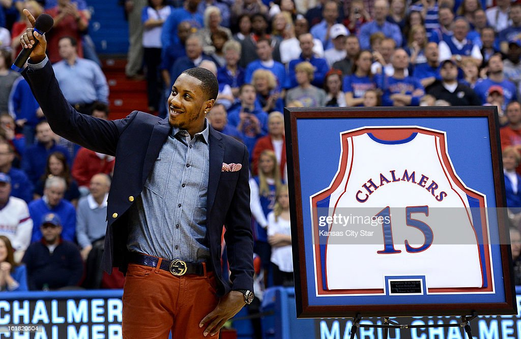 Former Kansas star Mario Chalmers waves to the crowd as his jersey is retired during a haltime ceremony against Texas at Allen Fieldhouse in Lawrence, Kansas, on Saturday, February 16, 2013.