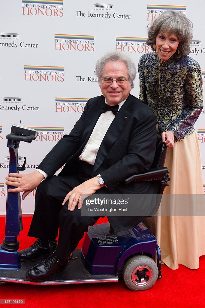 Former Kennedy Center honoree, Mr. Itzhak Perlman is pictured with his wife, Toby Perlman as they enter the event. The State Department dinner for The Kennedy Center Honors were held on Saturday December 1, 2012.