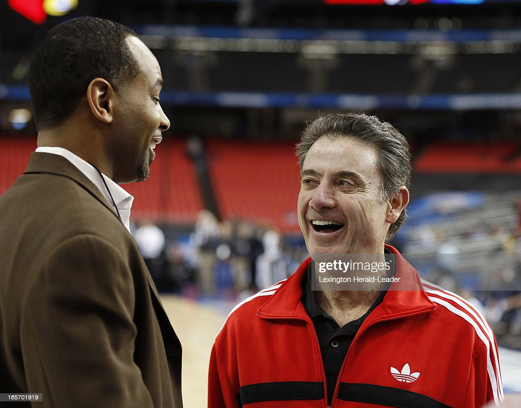 Former Kentucky player Derek Anderson talks with head coach Rick Pitino of the Louisville Cardinals as the team practices on Friday, April 5, 2013, in Atlanta, Georgia, n preparation for their semifinal game on Saturday.