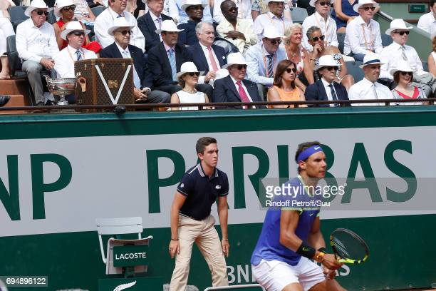 Former King of Spain Juan Carlos 1er watches Rafael Nadal near the Louis Vuitton trunk of the Cup during the Men Final of the 2017 French Tennis Open...