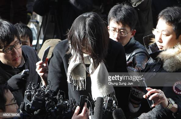 Former Korean Air Lines Co VP Cho HyunAh speaks with the media as she arrives at the Seoul western prosecutors' office on December 17 2014 in Seoul...