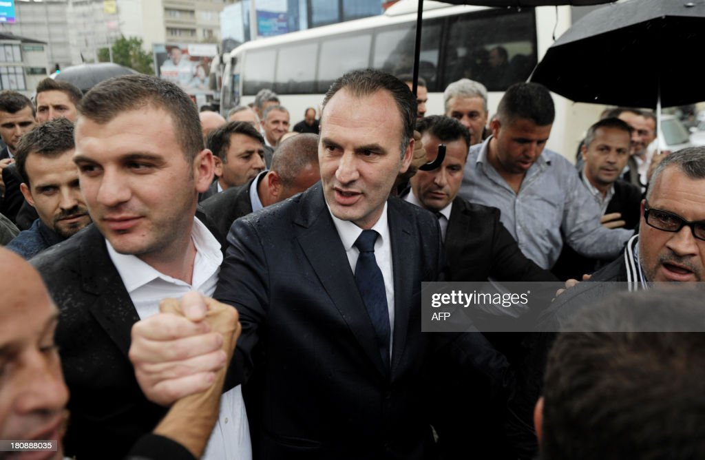 Former Kosovo Liberation Army (KLA) commander Fatmir Limaj greets his supporters after his acquittal in Pristina on September 17, 2013. A EU-led court set on Tuesday a top Kosovo rebel commander and his nine associates free from charges of war crimes in Kosovo.