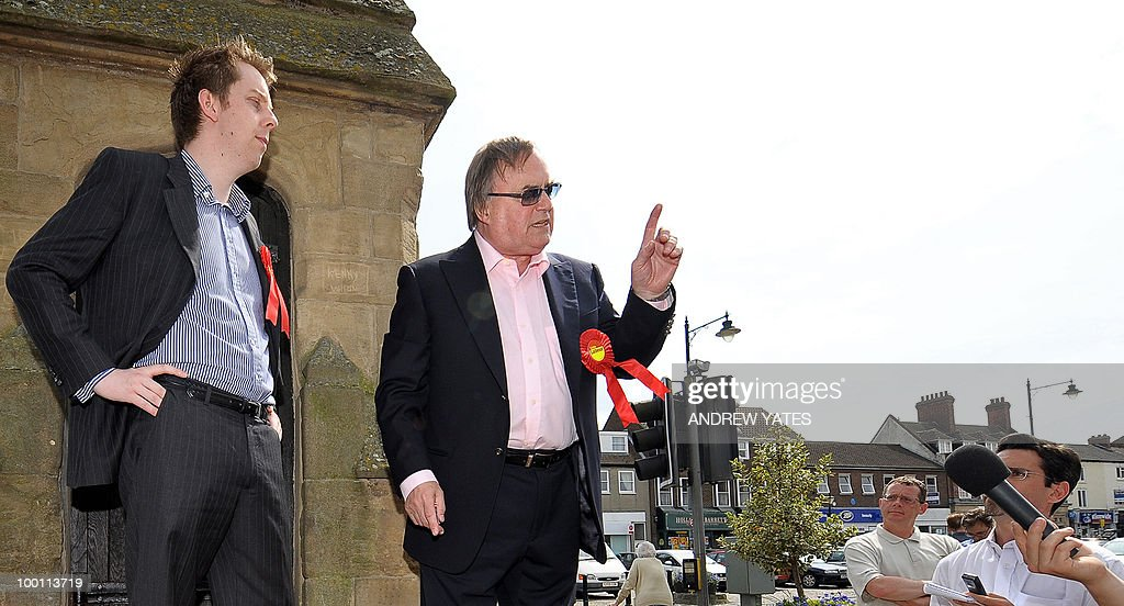 Former Labour Deputy Prime Minister, John Prescott (R), canvasses voters with leaves a fish and chip shop during an election campaign visit to Thirsk in northern England on May 21, 2010. Prescott was canvassing was with Roberts, Labour's prospective candidate for the Thirsk and Malton constituency seat, voting for which will take place on May 27, 2010.