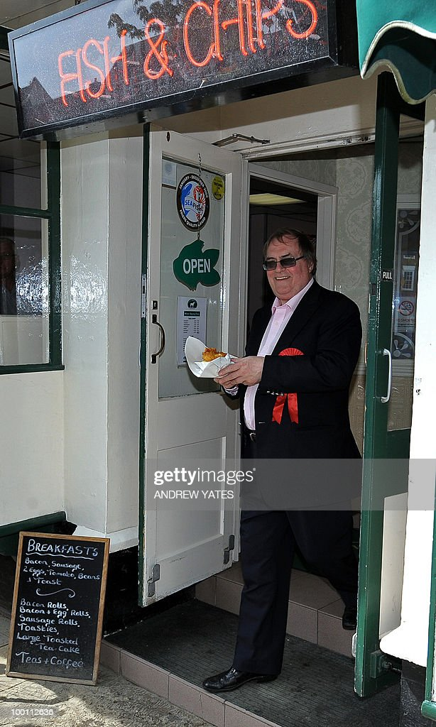 Former Labour Deputy Prime Minister, John Prescott, leaves a fish and chip shop during an election campaign visit to Thirsk in northern England on May 21, 2010. Prescott was canvassing was with Jonathan Roberts, Labour's prospective candidate for the Thirsk and Malton constituency seat, voting for which will take place on May 27, 2010.
