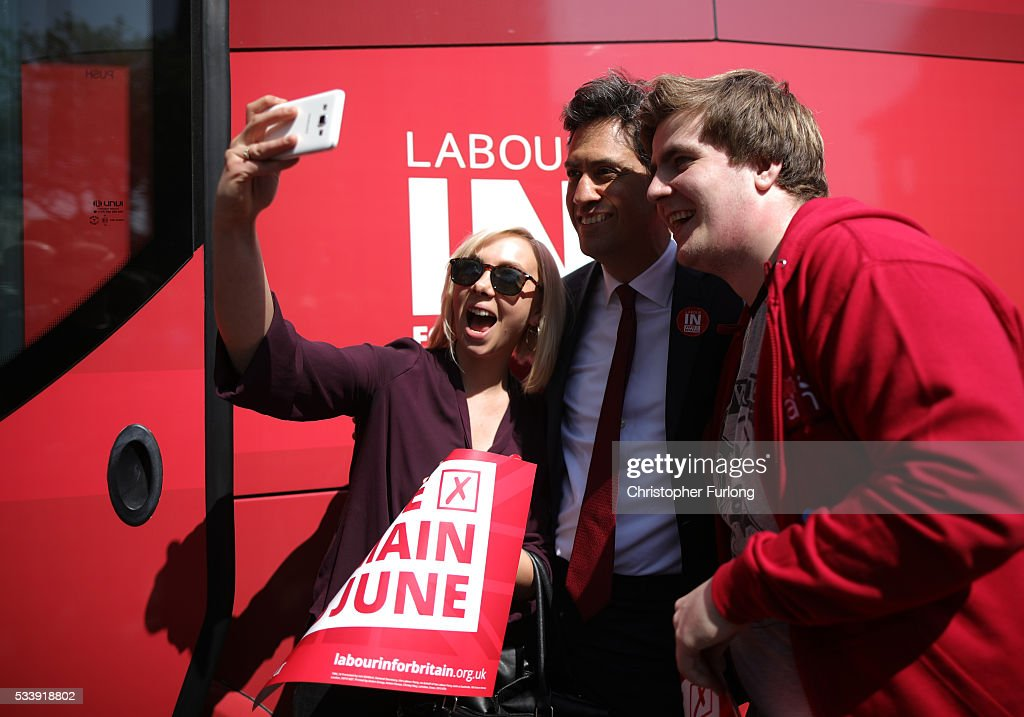 Former Labour leader Ed Miliband poses for selfies with people as he campaigns for remain votes while touring with the 'Labour In Battle Bus' at Flag Market on May 24, 2016 in Preston, England. The 'Labour In' campaign is hoping to persuade UK citizens to stay in the European Union when they vote in the EU Referendum on the June 23.