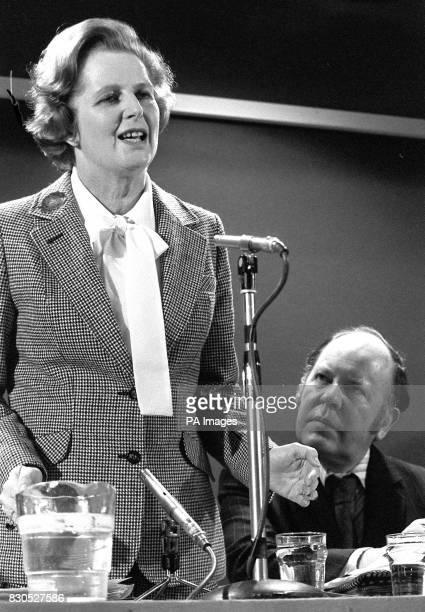 Former Labour Minister Mr Reg Prentice listens intently as Tory leader Mrs Margaret Thatcher introduces him at her General Election Press conference...