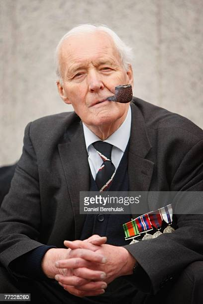 Former Labour MP Tony Benn smokes a pipe during an AntiWar rally on October 8 2007 in London England Antiwar protesters marched down Whitehall to...