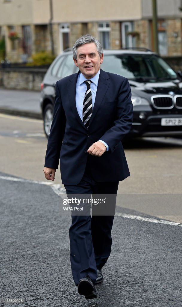 Former Labour Prime Minister <a gi-track='captionPersonalityLinkClicked' href=/galleries/search?phrase=Gordon+Brown&family=editorial&specificpeople=158992 ng-click='$event.stopPropagation()'>Gordon Brown</a> arrives for a visit to Kelty Primary school following the No vote success in the Scottish Referendum on September 19, 2014 in Fife, Scotland. The majority of Scottish people have today voted 'No' in the referendum and Scotland will remain within the historic union of countries that make up the United Kingdom.
