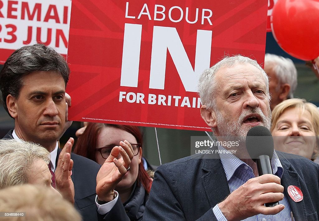 Former Leader of Britain's opposition Labour Party, Ed Miliband, (L) listens as the current leader, Jeremy Corybn, delivers a speech on the merits of Britain remaining in the European Union (EU), in Doncaster on May 27, 2016. With just under four weeks to go until the June 23 referendum, the Remain camp is on 53 percent and the Leave campaign on 47 percent, according to the What UK Thinks website's average of the most recent six opinion polls. / AFP / Lindsey Parnaby