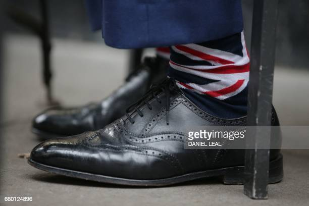 Former leader of the antiEU UK Independence Party Nigel Farage wears Union Flag socks as he drinks in a pub in Westminster in London on March 29...