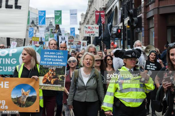 Former leader of the Green Party Natalie Bennett joined march through central London in protest against badger culling fox cubbing and driven grouse...