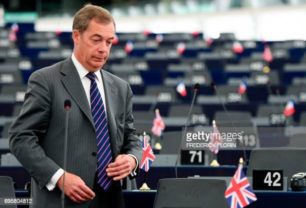 Former leader of the UK Independence Party Nigel Farage arrives for a meeting at the European Parliament in Strasbourg eastern France on June 14...