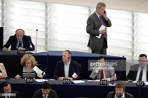 Former leader of the United Kingdom Independence Party Nigel Farage speaks on the phone as he arrives for a voting session at the European Parliament...