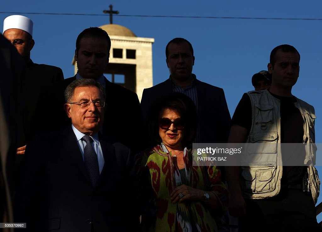 Former Lebanese Prime Minister Fouad Sniora and his spouse Huda arrive at the Grotto of Our Lady of Mantara in the southern Lebanese town of Maghdouche East of Sidon, on May 29, 2016, during the launching of an event by the Ministry of Tourism to put the Grotto of Maghdouche on the international religious tourism map. Magdouche, along with Lourdes in France, Fatima in Portugal and Medugorje in Bosnia & Herzegovina are expected to be put on the international religious tourism map. According to local tradition the Virgin Mary accompanied Jesus during his journey to Tyre and to Sidon and waited for him in the grotto at Magdoucheh. The grotto was discovered 400 years ago. / AFP / Patrick BAZ