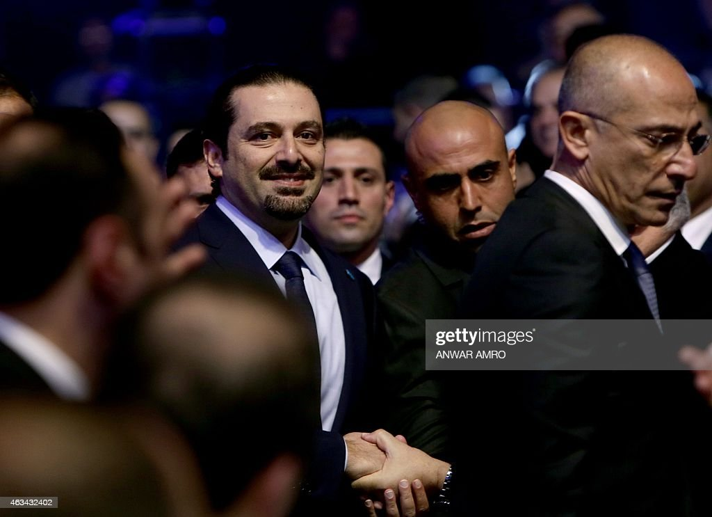 Former Lebanese prime minister <a gi-track='captionPersonalityLinkClicked' href=/galleries/search?phrase=Saad+Hariri&family=editorial&specificpeople=549774 ng-click='$event.stopPropagation()'>Saad Hariri</a> (C-L) arrives to deliver a speech during a gathering to mark the tenth anniversary of the assassination of his father and former prime minister <a gi-track='captionPersonalityLinkClicked' href=/galleries/search?phrase=Rafiq+Hariri&family=editorial&specificpeople=549773 ng-click='$event.stopPropagation()'>Rafiq Hariri</a>, on February 14, 2015, at the Biel Convention Centre in downtown Beirut. Lebanese paid their respects to the late former prime minister, a decade after his assassination in a massive and shocking suicide bombing that destabilised the fragile country.