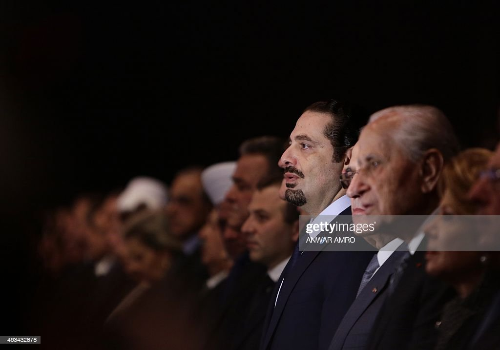 Former Lebanese prime minister <a gi-track='captionPersonalityLinkClicked' href=/galleries/search?phrase=Saad+Hariri&family=editorial&specificpeople=549774 ng-click='$event.stopPropagation()'>Saad Hariri</a> (4th from R) attends a gathering to mark the tenth anniversary of the assassination of his father and former prime minister <a gi-track='captionPersonalityLinkClicked' href=/galleries/search?phrase=Rafiq+Hariri&family=editorial&specificpeople=549773 ng-click='$event.stopPropagation()'>Rafiq Hariri</a>, on February 14, 2015, at the Biel Convention Centre in downtown Beirut. Lebanese paid their respects to the late former prime minister, a decade after his assassination in a massive and shocking suicide bombing that destabilised the fragile country. AFP PHOTO / ANWAR AMRO