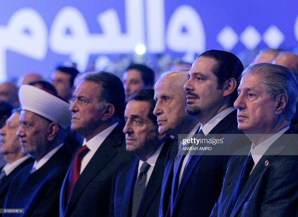 Former Lebanese prime minister Saad Hariri (2nd from R) attends a gathering to mark the 11th anniversary of the assassination of his father and Lebanon's former prime minister, on February 14, 2016, in the capital Beirut. Rafiq Hariri and 22 others, including a suspected suicide bomber, died in a massive car bomb blast on the Beirut waterfront on February 14, 2005. / AFP / ANWAR AMRO