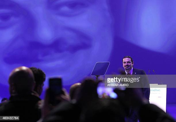 Former Lebanese prime minister Saad Hariri stands on stage after delivering a speech during a gathering to mark the tenth anniversary of the...