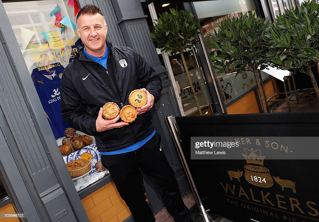 Former Leicester City player Steve Walsh pictured with Walkers 'special pies' during a Leicester Backing the Blues Campaign in support of Leicester City on April 29, 2016 in Leicester, England.