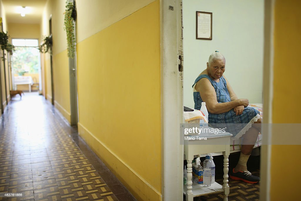 Former leprosy patient Dalva Monteiro Cavalcante sits in her room at Hospital Curupaiti part of a former leprosy colony on June 10 2015 in the...