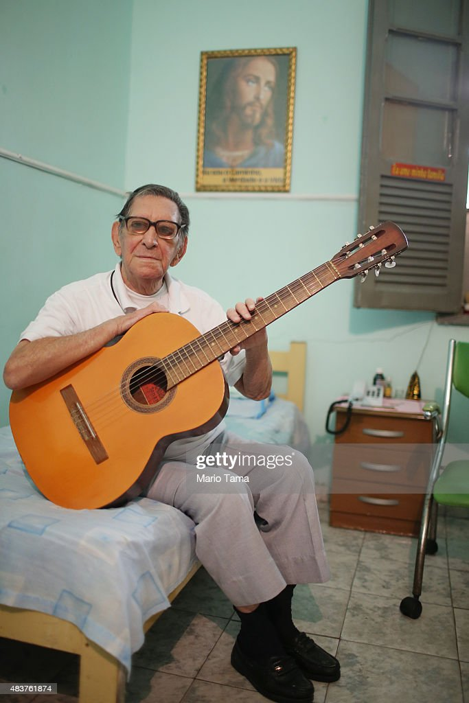 Former leprosy patient Elias Miguel Amorozone poses in his room in Hospital Curupaiti part of a former leprosy colony on June 10 2015 in the...