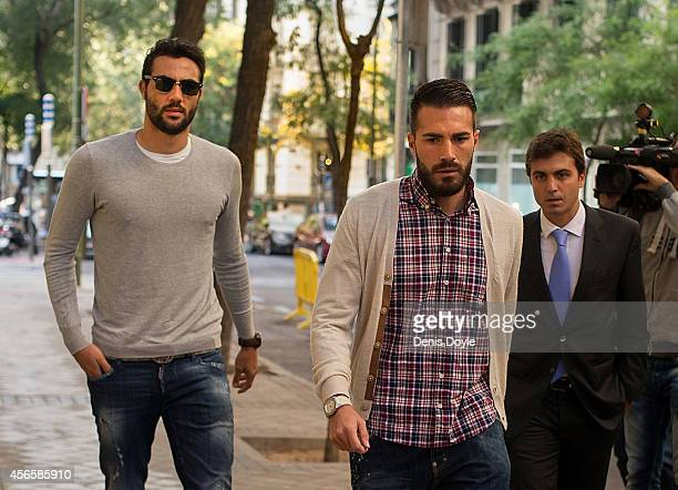 Former Levante UD players Xavi Torres of Real Betis Balompie and Vicente Iborra of Sevilla FC arrive at the Spanish AntiCorruption headquarters on...