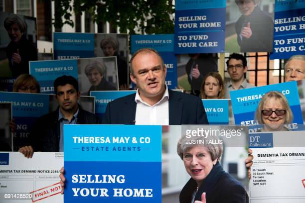 Former Liberal Democrat cabinet minister Ed Davey demonstrates with campaigners against British Prime Minister Theresa May's social care policy or...