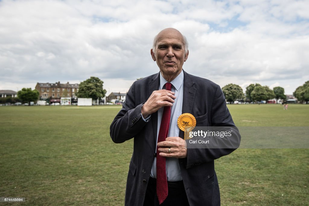 Former Liberal Democrat Secretary of State for Business, Innovation and Skills, Vince Cable, adjusts his tie during the launch of his campaign to return to parliament and warning of the risk of a second 'economic storm' caused by a hard Brexit, on April 28, 2017 in Twickenham, England. Britain is to go to the polls on June 8, after British Prime Minister Theresa May called for a snap general election.