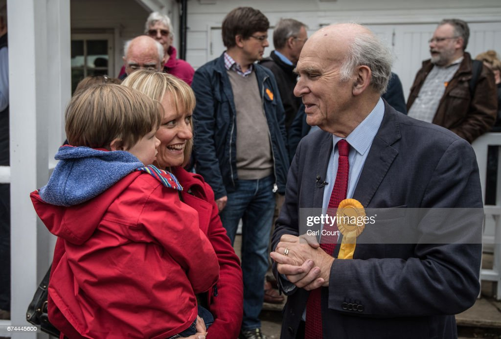 Former Liberal Democrat Secretary of State for Business, Innovation and Skills, Vince Cable, speaks with a supporter at the launch of his campaign to return to parliament where he also warned of the risk of a second 'economic storm' caused by a hard Brexit, on April 28, 2017 in Twickenham, England. Britain is to go to the polls on June 8, after British Prime Minister Theresa May called for a snap general election.