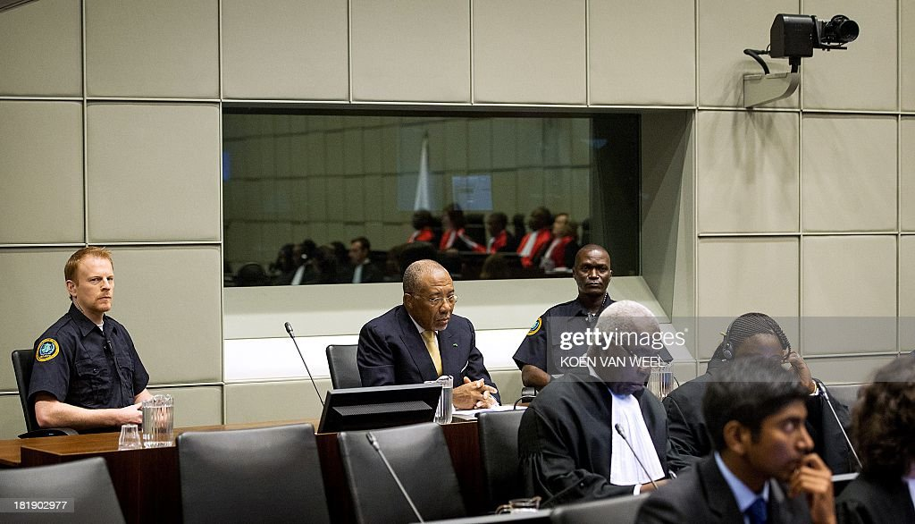 Former Liberian President Charles Taylor (C) waits for the start of his appeal judgement on September 26, 2013 in the courtroom of the Special Court for Sierra Leone in The Hague. A UN-backed court on Thursday hands down its final verdict against Liberian ex-president Charles Taylor, jailed initially for 50 years for arming rebels during Sierra Leone's brutal 1990s civil war. The appeals judges' ruling at the Special Court for Sierra Leone (SCSL) marks the end of the road for the former west African strongman's seven-year long trial.