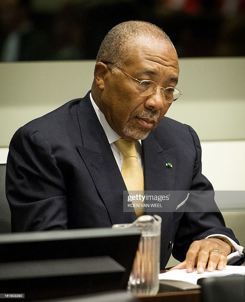 Former Liberian President Charles Taylor waits in the courtroom of the Special Court for Sierra Leone in The Hague prior to the appeal judgement on September 26, 2013. The appeals judges' ruling at the Special Court for Sierra Leone (SCSL) marks the end of the road for the former west African strongman's seven-year long trial. AFP PHOTO / POOL / KOEN VAN WEEL