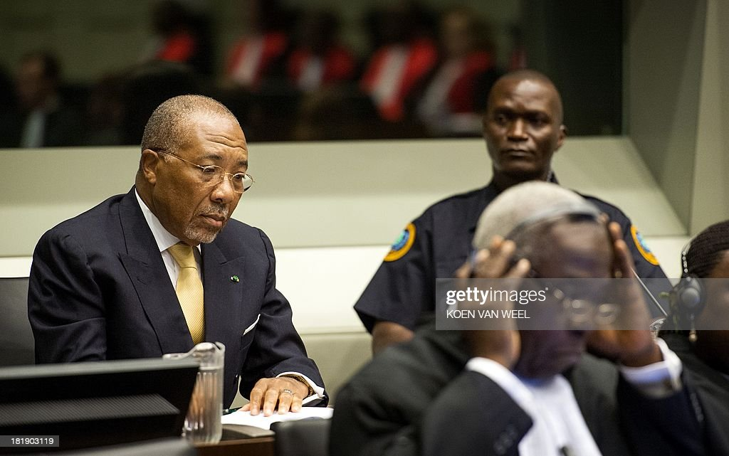 Former Liberia's President Charles Ghankay Taylor (L) waits in the courtroom of the Special Court for Sierra Leone in The Hague prior to the appeal judgement on September 26, 2013. The appeals judges' ruling at the Special Court for Sierra Leone (SCSL) marks the end of the road for the former west African strongman's seven-year long trial.