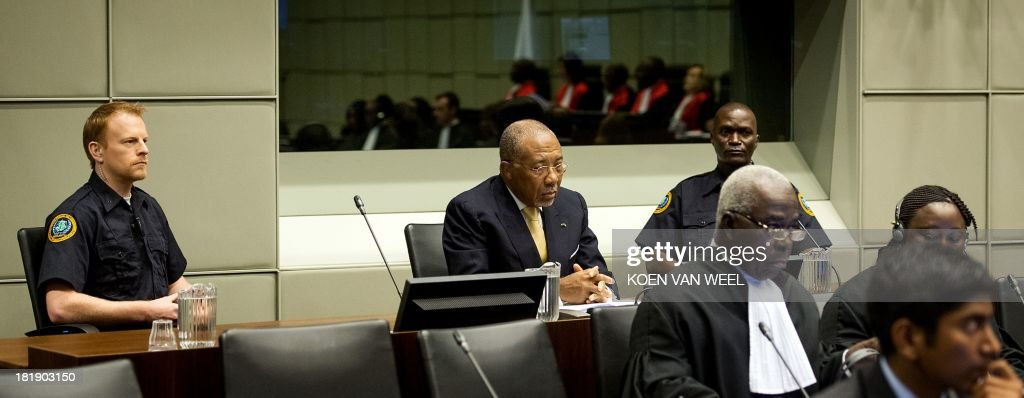 Former Liberia's President Charles Ghankay Taylor (C) waits in the courtroom of the Special Court for Sierra Leone in The Hague prior to the appeal judgement on September 26, 2013. The appeals judges' ruling at the Special Court for Sierra Leone (SCSL) marks the end of the road for the former west African strongman's seven-year long trial. AFP PHOTO / POOL / KOEN VAN WEEL